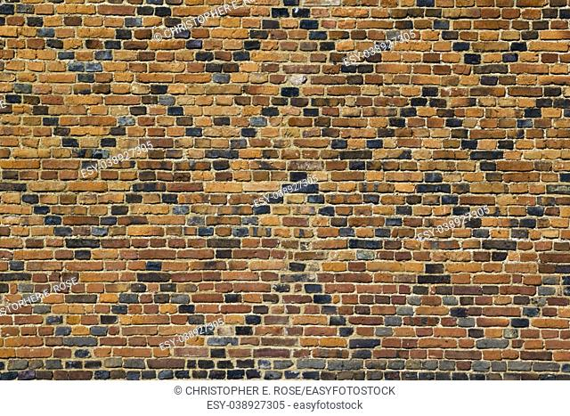 Old patterned red brick wall full frame texture background