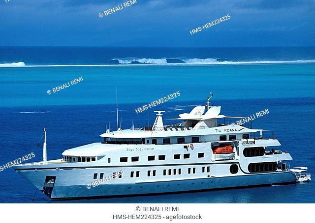 France, French Polynesia, Tia Moana Yacht sailing off of the island of Huahine