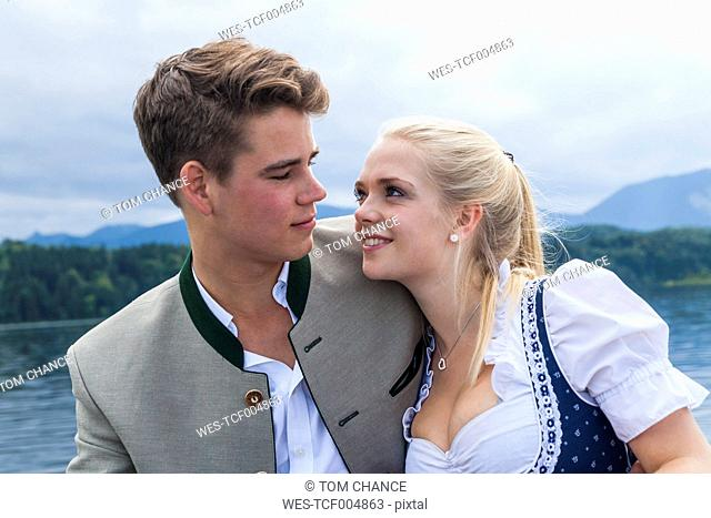 Germany, Bavaria, portrait of young couple wearing traditional clothes