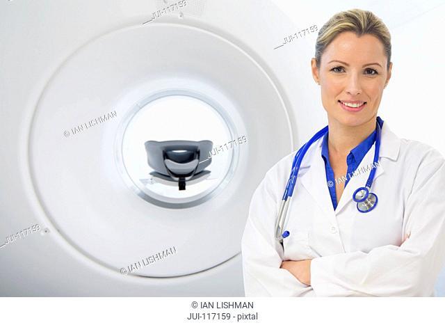 Portrait Of Female CAT Scan Operator In Hospital