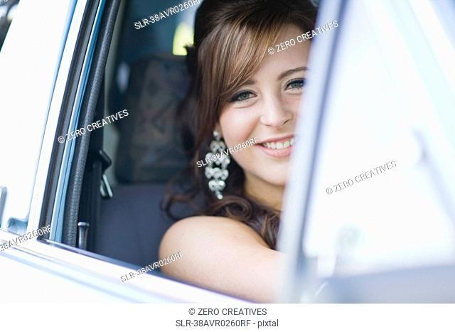 Teenage girl smiling in car