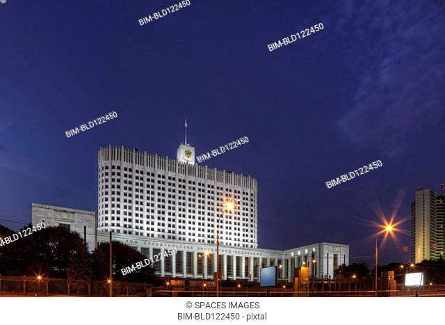 Large building illuminated at night, Moscow, Russia