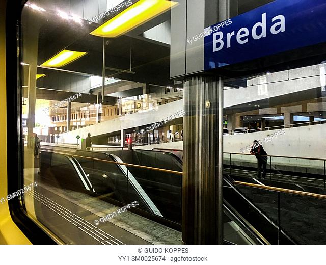 Breda, Netherlands. View on a railway stations's platform during a commute with an intercity train towards Randstad