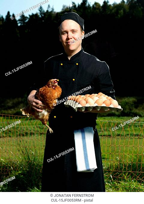 Chef with hen and eggs