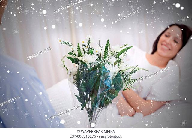 Composite image of flowers are brought to patient