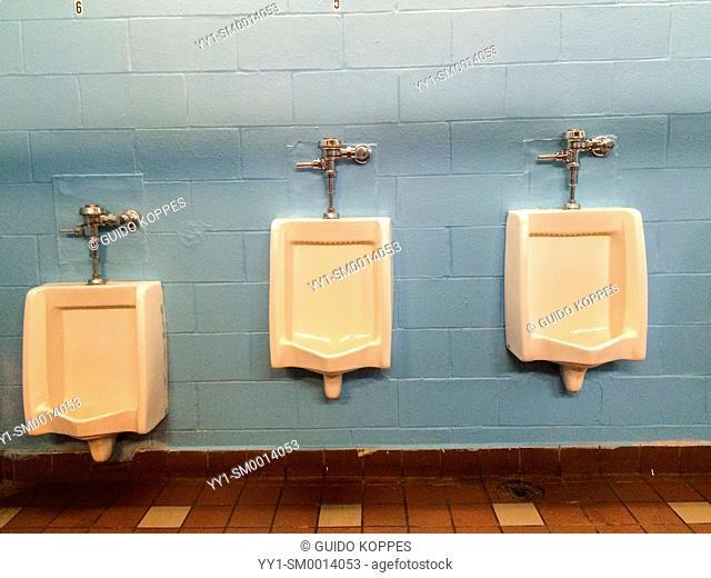 New York, USA. Gentleman's urinoirs in a restroom on Coney Island