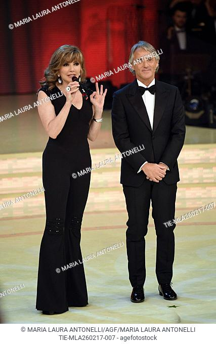 The host Milly Carlucci with the soccer coach Roberto Mancini at tv show Ballando con le stelle, Rome, ITALY-25-02-2017