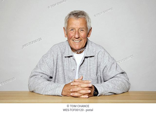 Senior Man at table, close-up