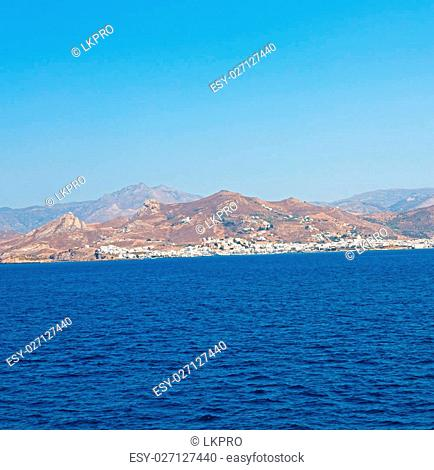 in cyclades island harbor and boat santorini naksos europe house construction old history