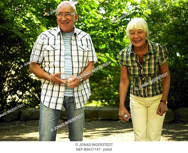 Senior citizen playing boule