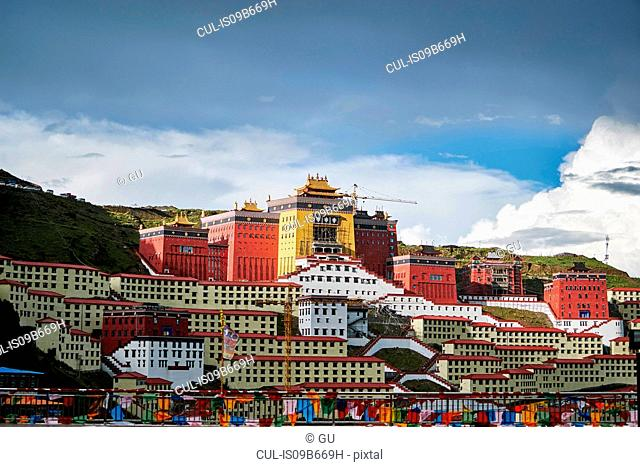 Katok Monastery and building development on hillside, Baiyu, Sichuan, China