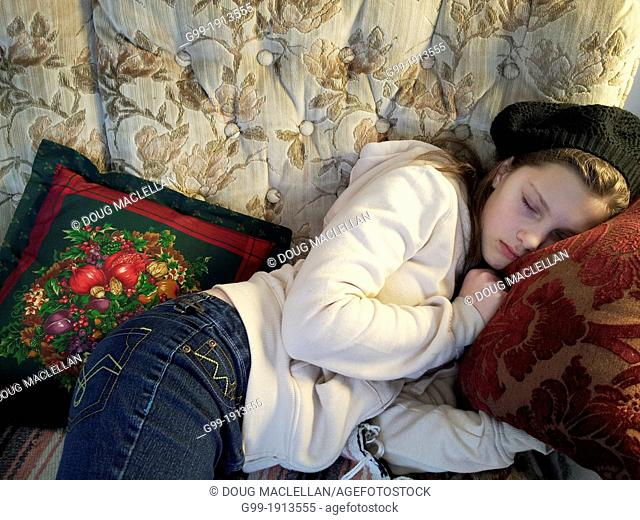 Girl, 11 years old, sleeping on couch, Sault Ste Marie, Ontario, Canada