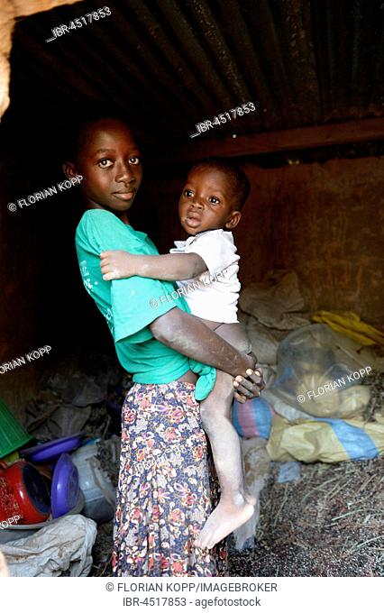 Girl, 11 years old carrying baby, Toeghin village, Oubritenga province, Plateau Central region, Burkina Faso