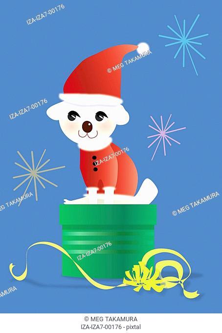 Santa dog sitting on a gift