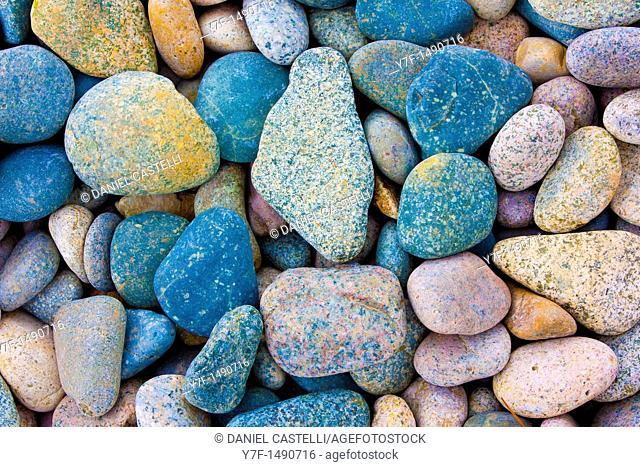 Multicolored pebbles on beach