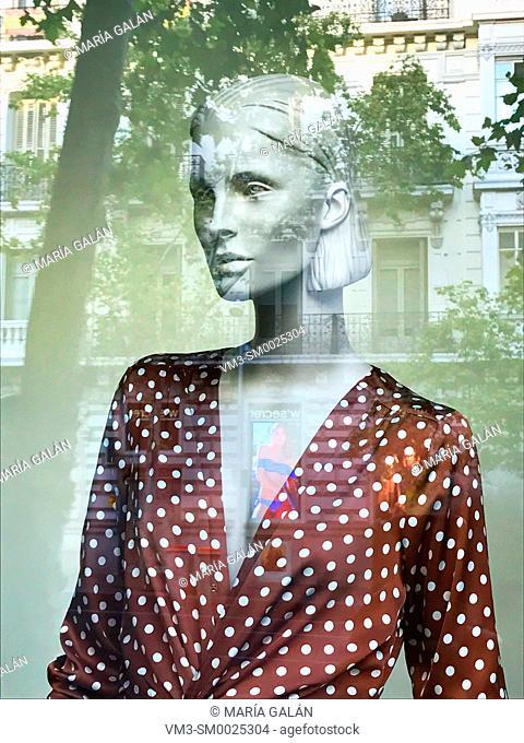 Portrait of mannequin in a shop window. Serrano street, Madrid, Spain