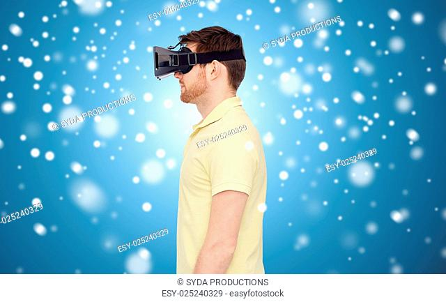 technology, augmented reality, winter, christmas and people concept - young man with virtual headset or 3d glasses over blue background and snow