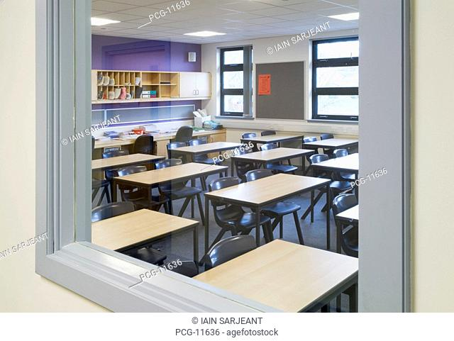 Science classroom and laboratory in a modern secondary school with tables and desks, cupboards and equipment