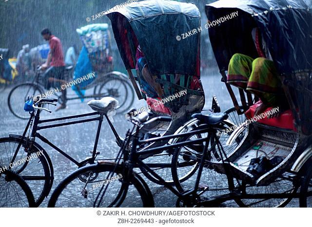 Rickshaw on street during rain in Dhaka