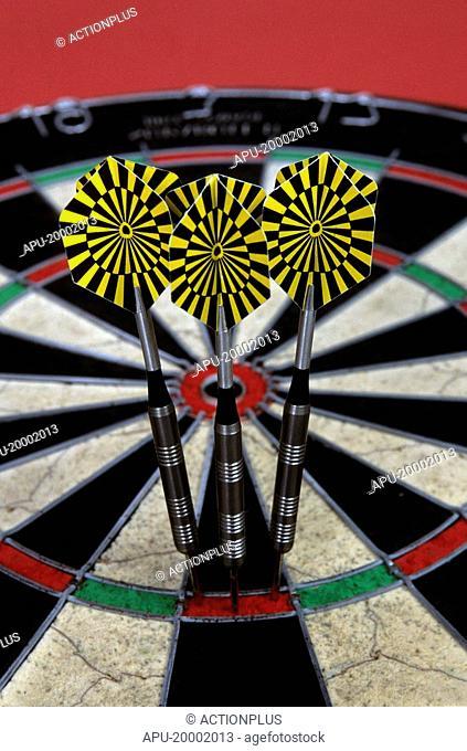 Close up of dart board with three darts
