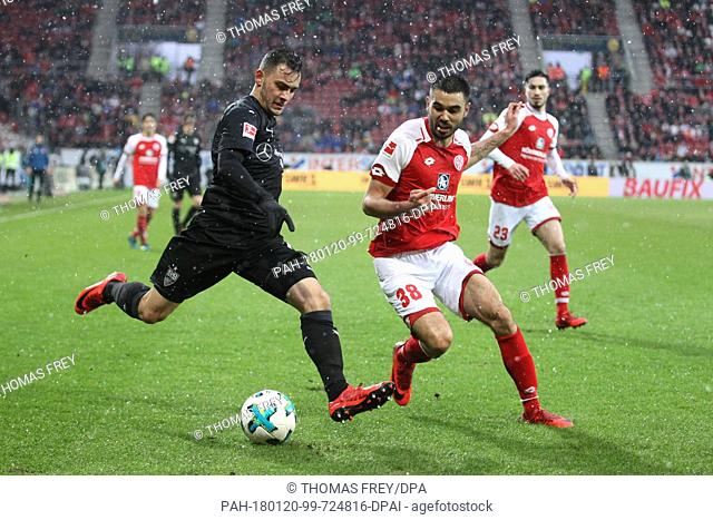 Mainz's Gerrit Holtmann (r) tries to take the ball from Stuttgart's Anastasios Donis during the German Bundesliga football match between FSV Mainz 05 and VfB...