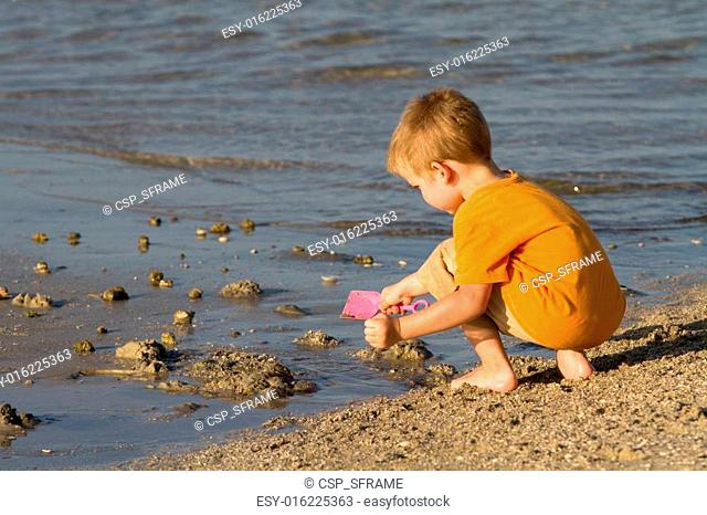 Boy Playing At Beach
