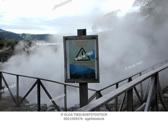 Danger, boiling water. Steam rises from the hotsprings of Furnas Sao Miguel island, Azores islands, Portugal