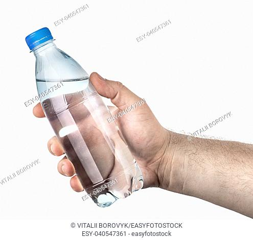 Closed plastic water bottle in hand isolated on white background