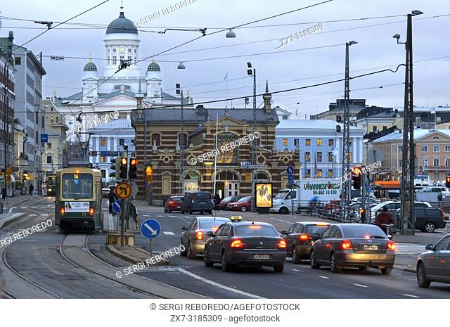 General view of the Helsinki city with the tram, market, and the Senaatintori Lutheran Cathedral from the Eteläranta street