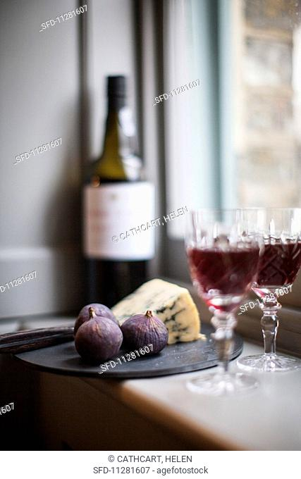 An arrangement of red wine, blue cheese and figs