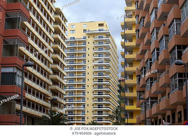 apartment blocks and hotel accommodation on a street in the resort area of puerto de la cruz tenerife canary islands spain