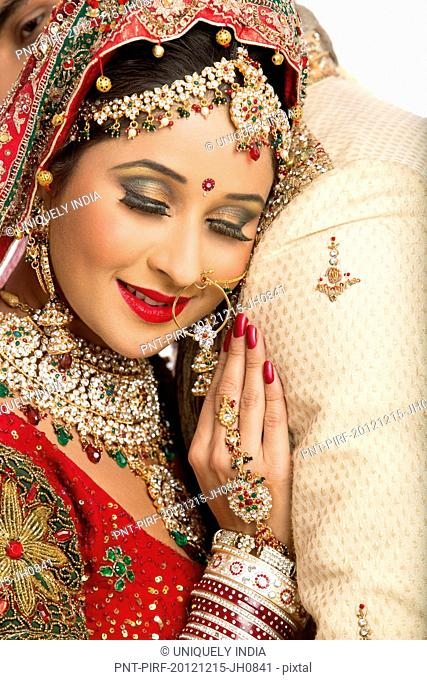 Close-up of an Indian newlywed couple embracing each other