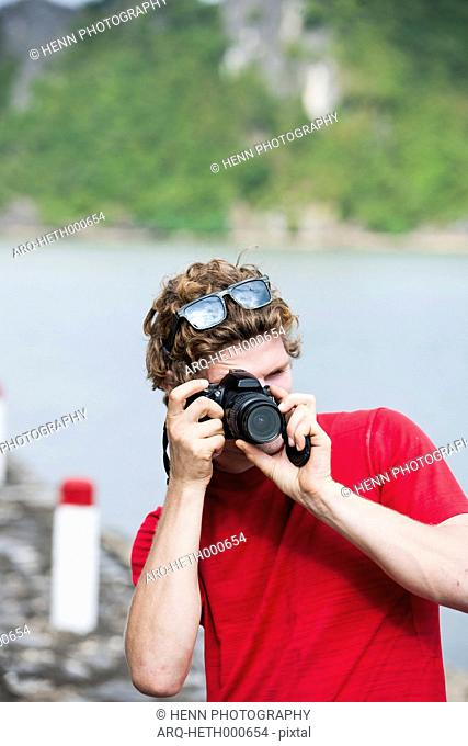 Close-up Of A Man Taking Picture From The Camera