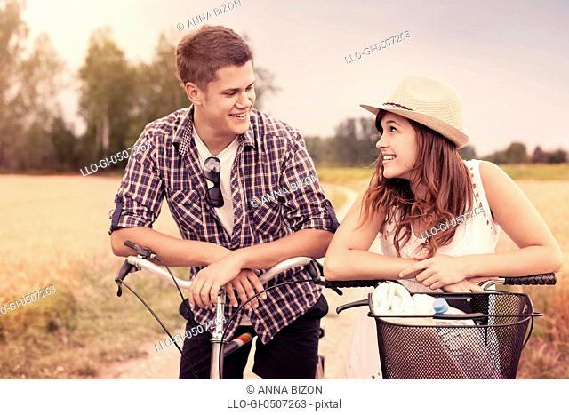 Portrait of happy couple on bicycles, Debica, Poland