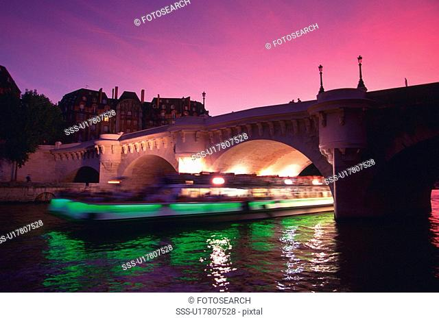 Image of the Seine and a Bridge, a Tourist Boat Under it, Side View, Blurred Motion, Paris, France