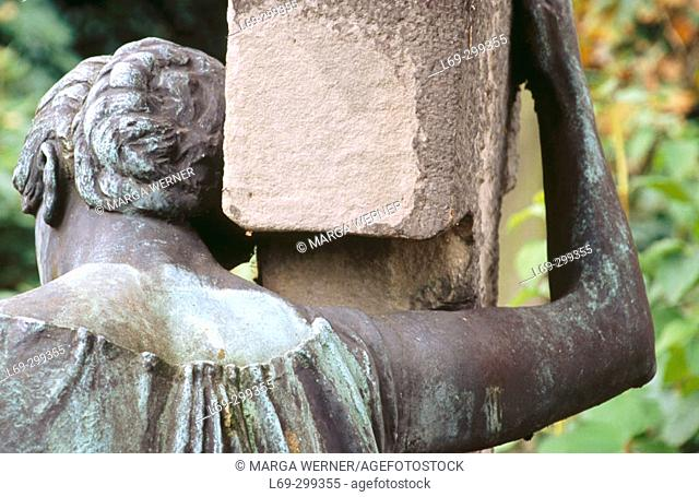 Mourning lady on a gravestone. Ohlsdorf Cementery-Park. Hamburg, Germany