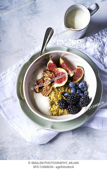 Breakfast bowl with Quinoa and soy yoghurt and fresh fruit