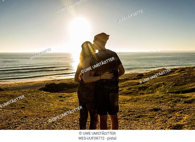 Back view of young couple at seaside at seaside