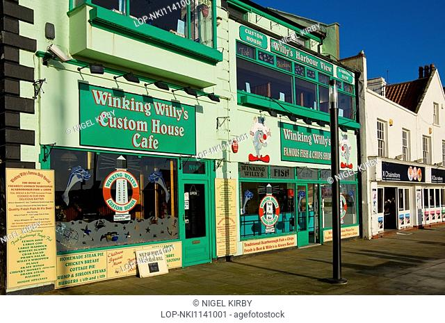 England, North Yorkshire, Scarborough, 'Winking Willy's Custom House Cafe' and 'Famous Fish and Chip Shop' restaurants on the seafront at Scarborough