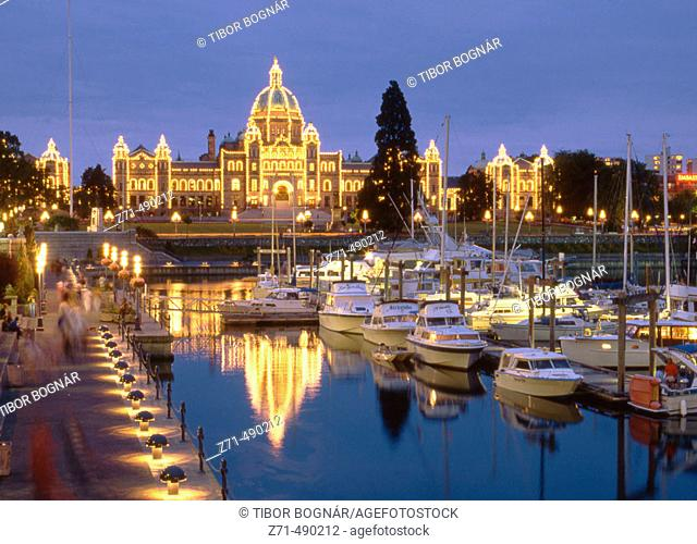 British Columbia Parliament buildings and inner harbour at dusk. Victoria, BC, Canada