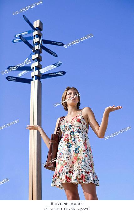 Confused woman at crossroads