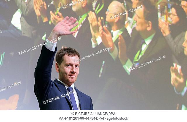 01 December 2018, Saxony, Leipzig: Michael Kretschmer (CDU), Prime Minister of Saxony, waves after his speech at the state party conference of CDU Saxony