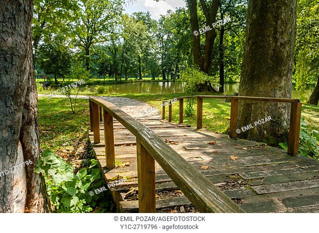 Luznica near Zapresic Zagreb in Croatia and its park with wooden footbridge