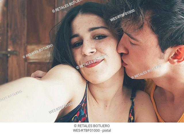 Portrait of young couple taking selfie