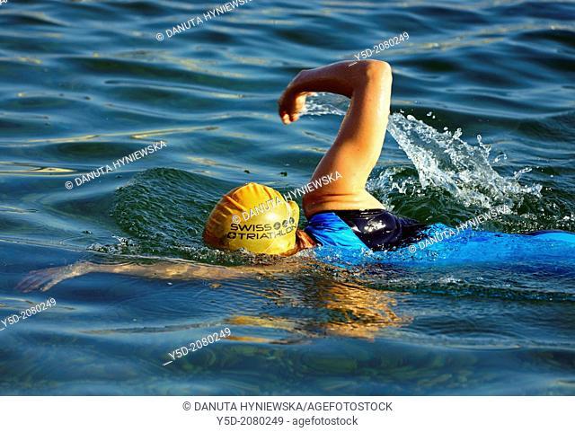 single female athlete swimming in Lake Geneva, swimming race, 25th International Geneva Triathlon, July 21, 2013, Geneva, Switzerland