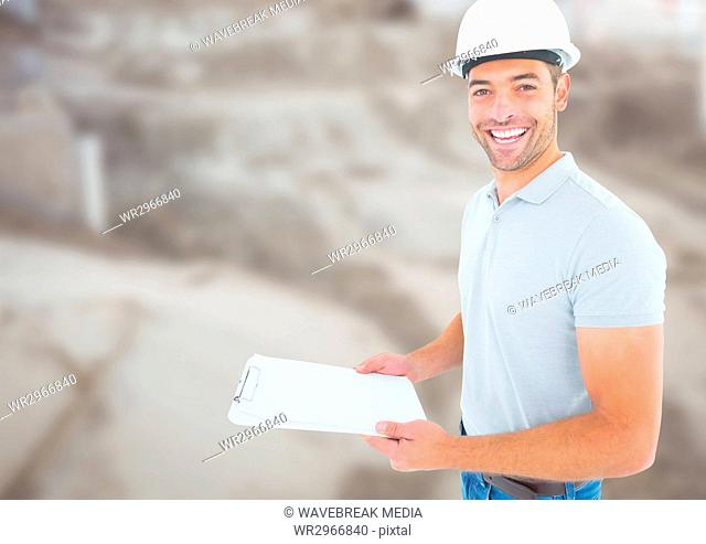 Construction Worker with chart in front of construction site