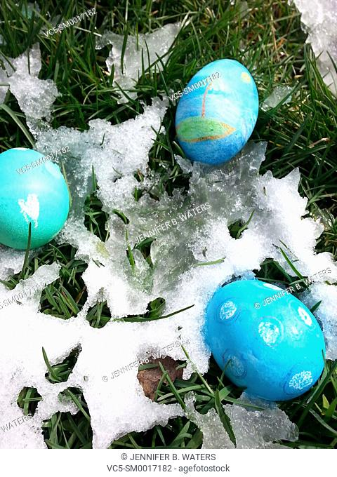 Easter eggs outdoors after a late spring snowfall