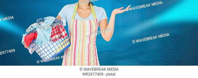 Cleaner holding laundry basket with bright background