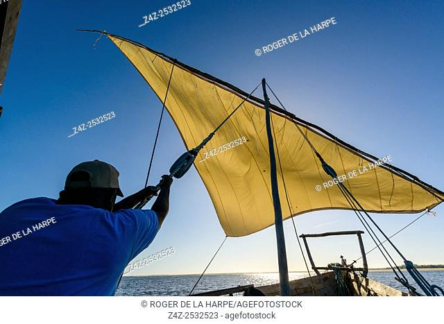 Hoisting the sail in a Dhow. Ibo Island. Mozambique