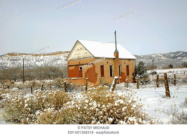 Old Adobe Schoolhouse in Snow